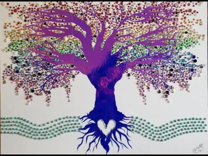 Treet plantet ved rennende vann